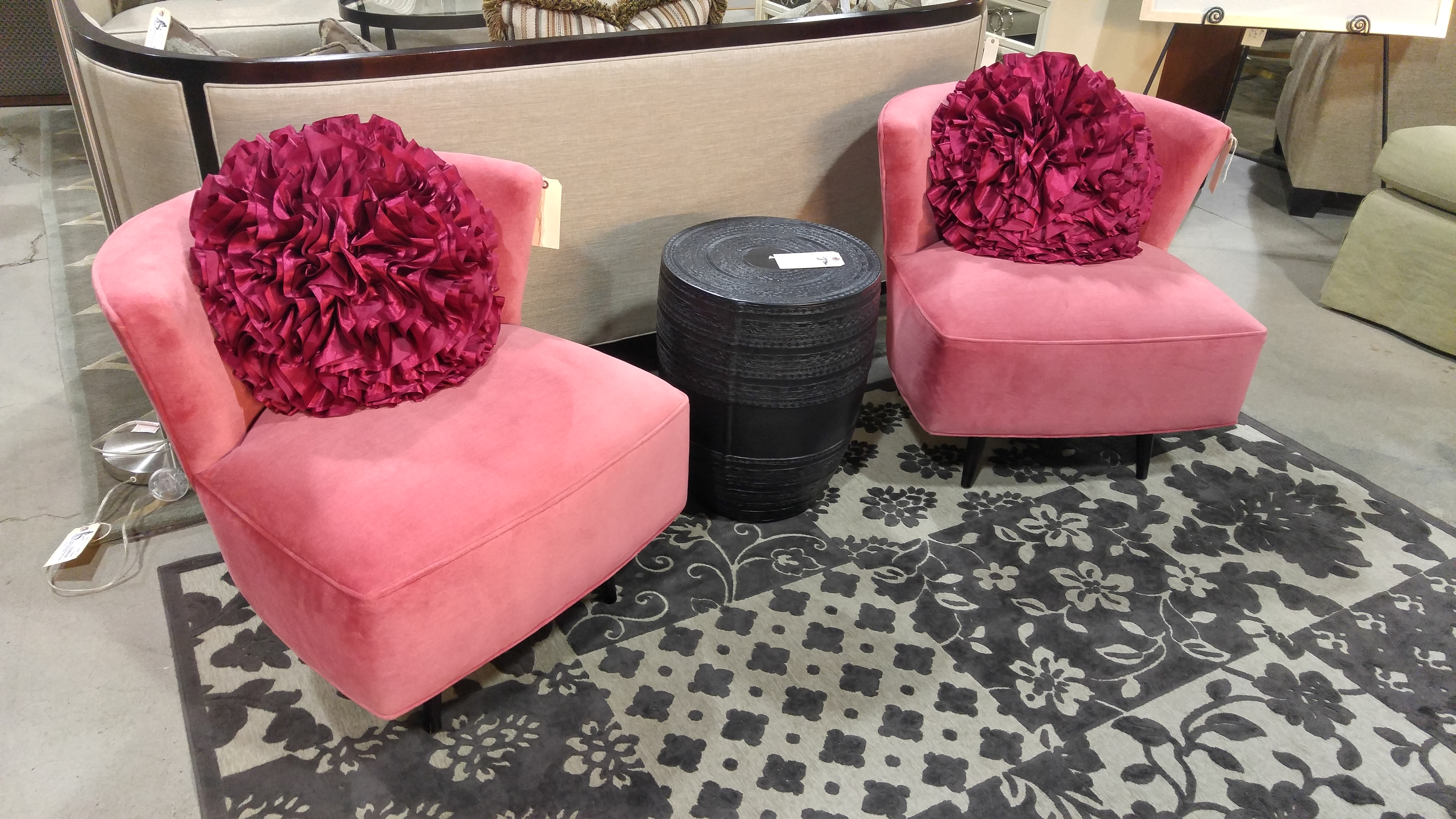 Playfully Adorable, We Have Two Peony Pink Velvet Occasional Chairs With  Espresso Wood Legs, Set On A Swivel From McCreary Modern.