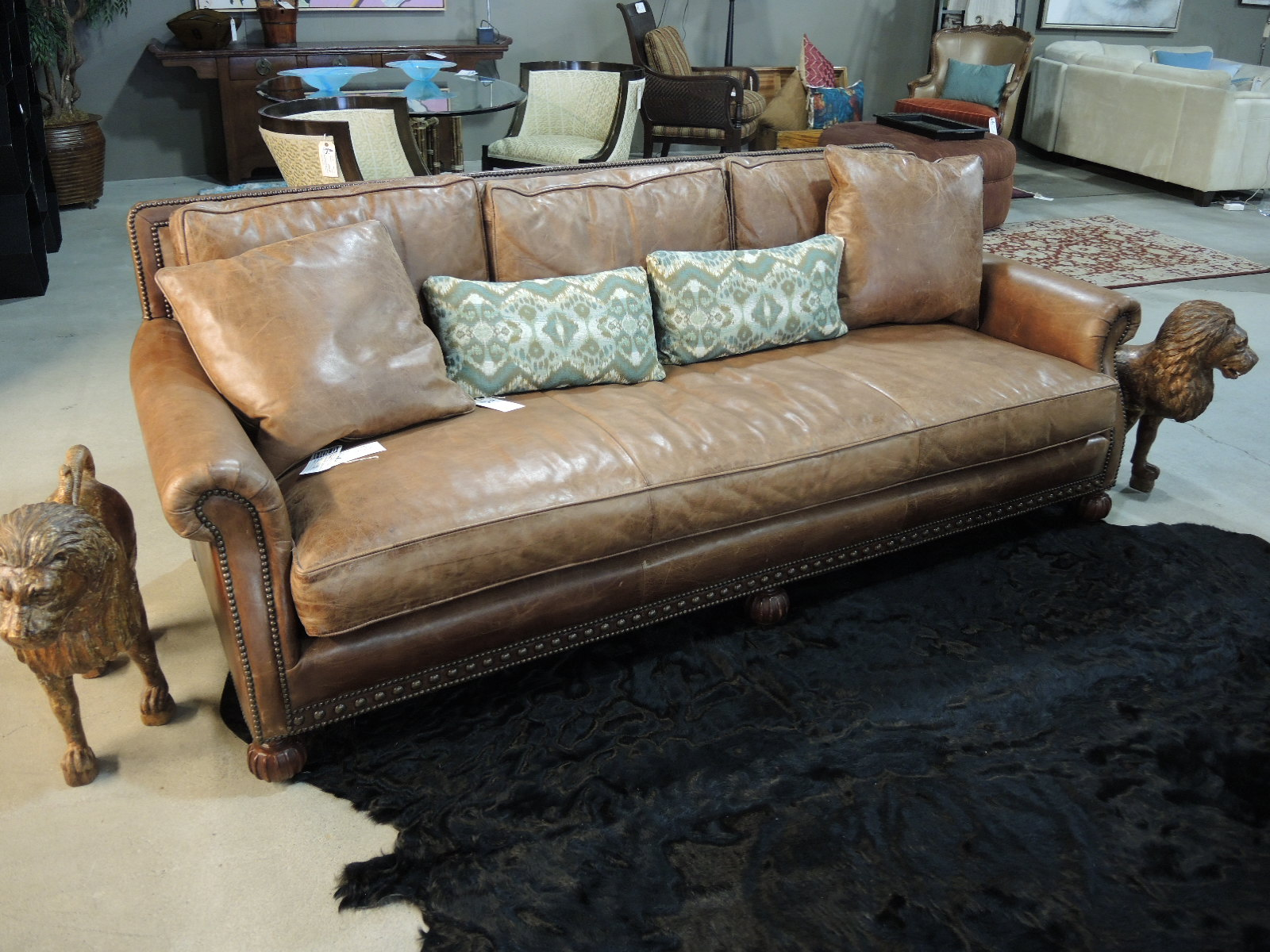 lovingly distressed brown leather upholsters this luxuriously exceptional u0027aran islesu0027 sofa from ralph lauren home features include a single downblend